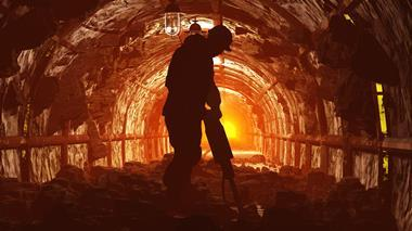 Silhouette of worker in a mine
